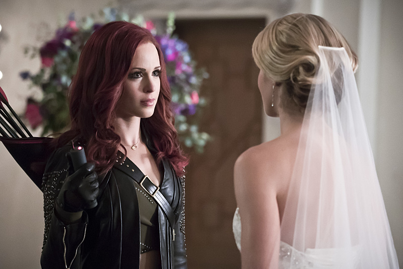 "Arrow -- ""Broken Hearts"" -- Image AR416a_0221b.jpg -- Pictured (L-R): Amy Gumenick as Carrie Cutter/Cupid and Emily Bett Rickards as Felicity Smoak -- Photo: Katie Yu/The CW -- © 2016 The CW Network, LLC. All Rights Reserved."