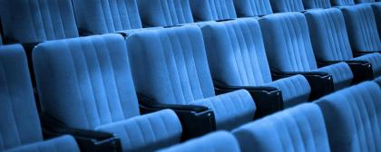 AMF1WH Empty chairs at cinema or theater. Blue tone.